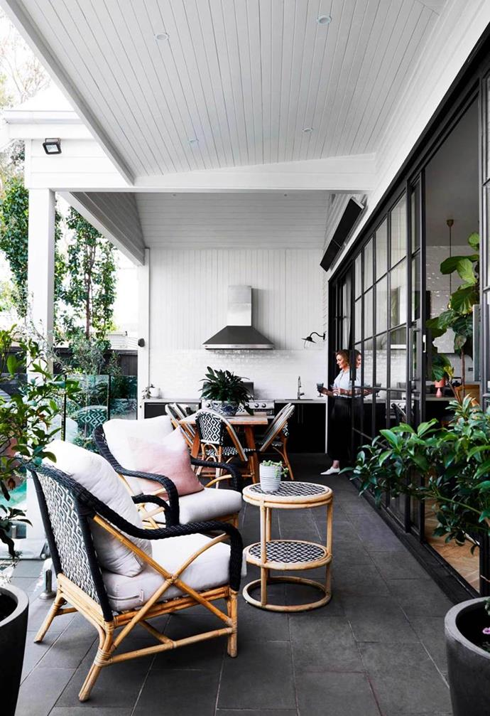 *Connecting seamlessly with the indoors courtesy of sliding steel-framed doors, the outdoor kitchen features black cabinetry and a sleek stainless steel rangehood to finish the look. Styling: Heather Nette King / Photography: Armelle Habib / Story: Australian House & Garden*