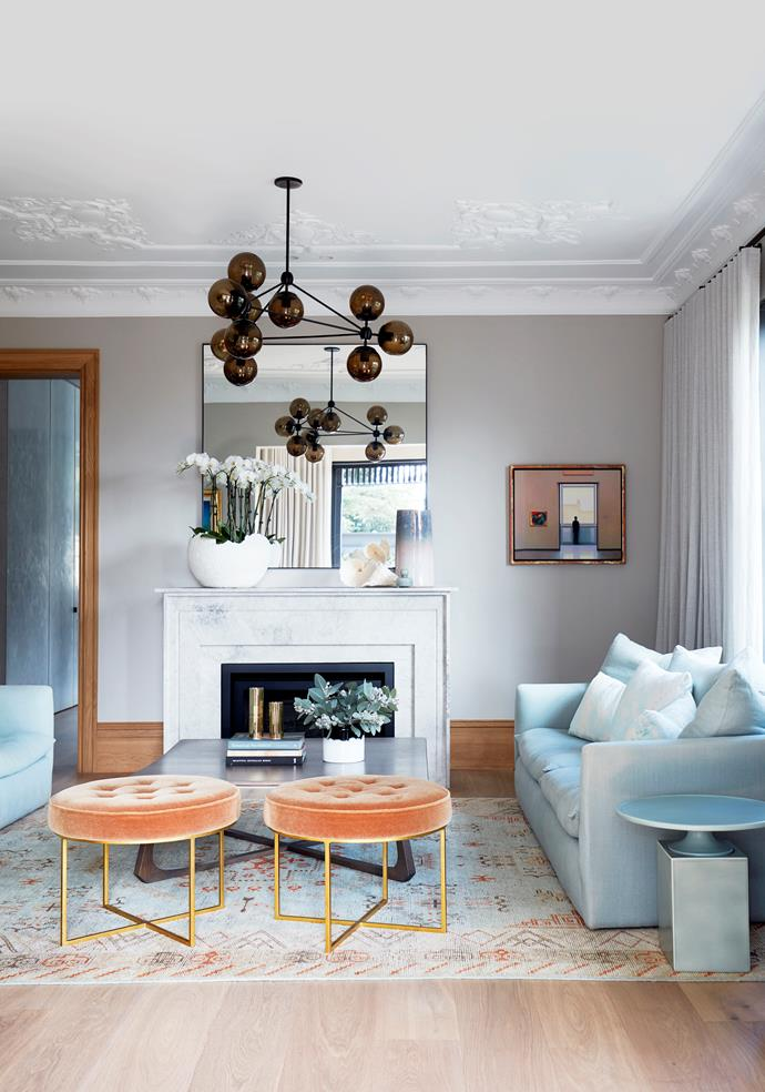 The formal living room at the front of the house is a symphony of pastel hues. Sofa and armchairs from Jardan, padded velvet stools from Coco Republic, coffee table from Workshopped with brass vases from Greg Natale, and Christophe Delcourt 'Ouk' side table from Ondene, all on a rug from Robyn Cosgrove. Roll & Hill light from Space. Artwork is by Chris Langlois.