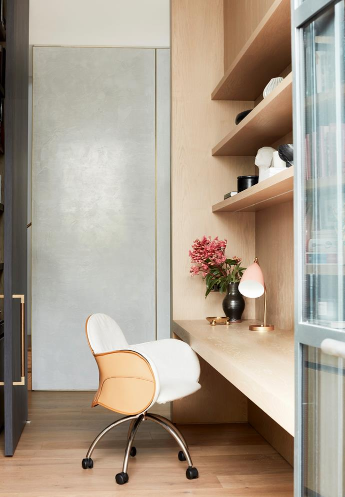 The study is an exercise in simplicity with custom-designed desk and shelves by Pohio Adams in natural oak. DePadova 'Serbelloni' chair from Boffi and Gubi desk light from Cult. On lower shelf, Baruk grey sculpture by Kristiina Engelin from Curatorial+Co.