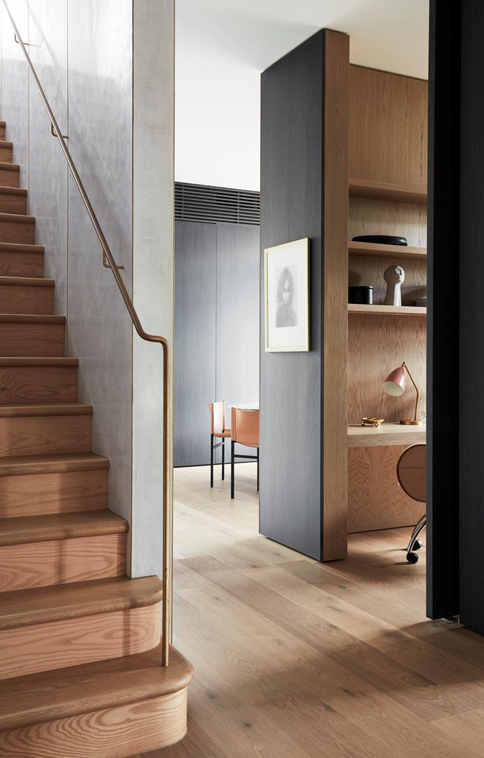 Looking from the hallway to the study and the dining room beyond. Stair wall is in Rockcote Venetian plaster with custom brass handrail. Flooring in Hekke oak from Tongue n Groove. A Robert Dickerson artwork in charcoal hangs in the hallway.