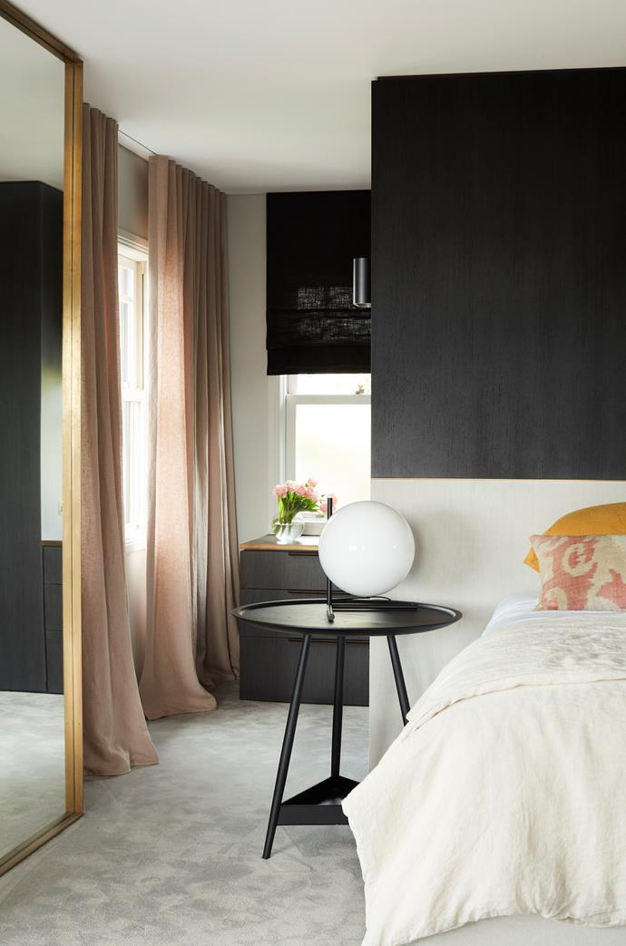 The master bedroom suite on the top floor has a custom-designed bedhead by Pohio Adams in upholstered linen. 'Clyde' side table from Spence & Lyda with Flos table lamp from Euroluce.