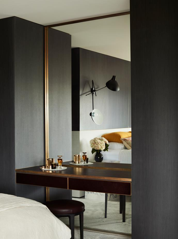Astep 'VV Cinquanta' twin wall light from Hub. Custom-designed dressing table and mirror by Pohio Adams with leather top and front. Stool and bench by Poliform.