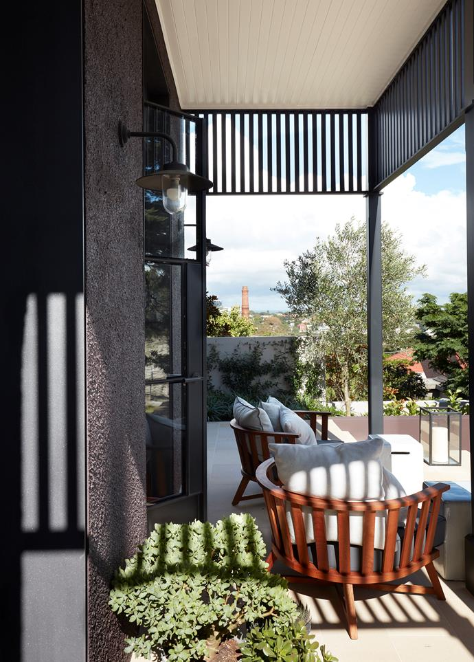 The terrace outside the formal living area has Gervasoni chairs from Anibou.