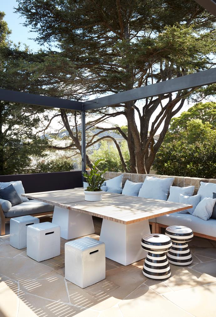 The front terrace enjoys a leafy outlook to the city. Gervasoni 'InOut' outdoor furniture from Anibou. Sandstone paving from Gosford Quarries.