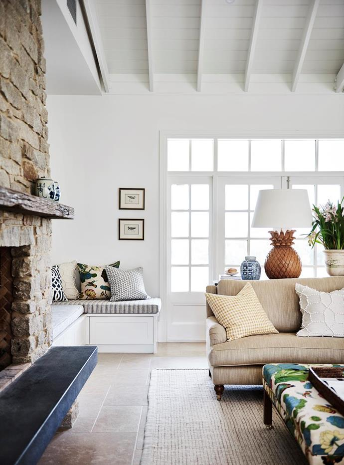 """French doors lead the eye to the high truss ceilings in the living room of this [modern Australian farmhouse](https://www.homestolove.com.au/modern-australian-farmhouse-design-21558