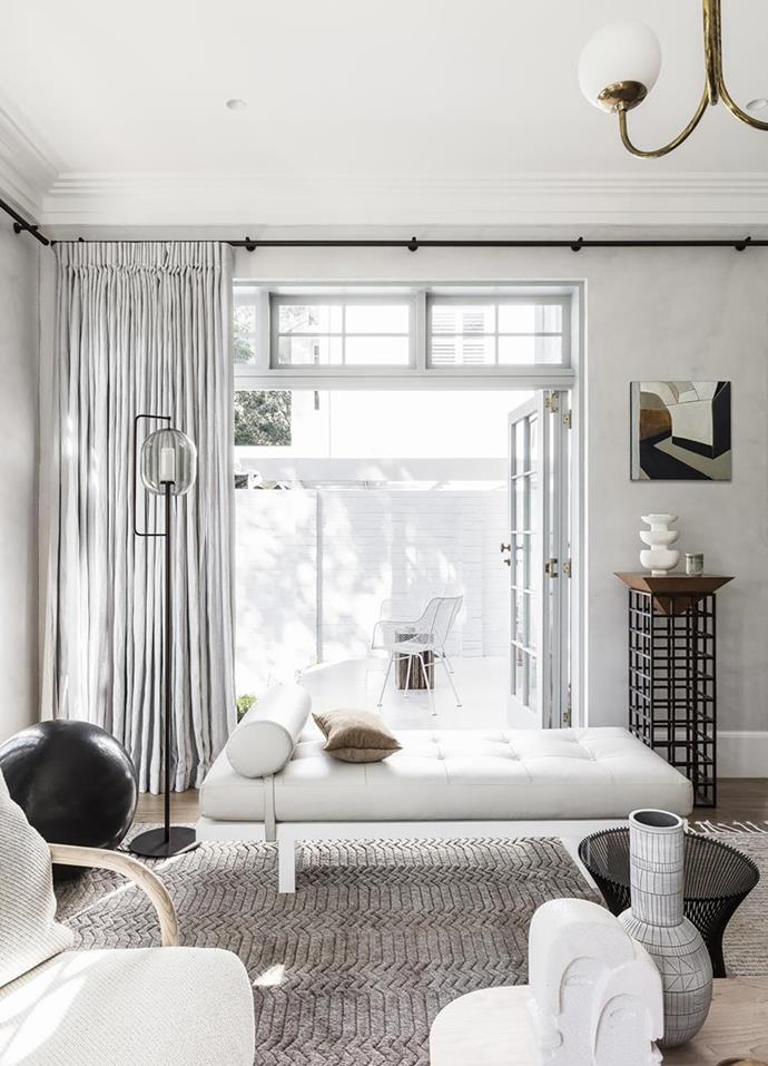 """From the living room, French doors pivot onto an alfresco dining area of this [Victorian-era home in Sydney](https://www.homestolove.com.au/contemporary-update-for-a-sydney-heritage-home-19571
