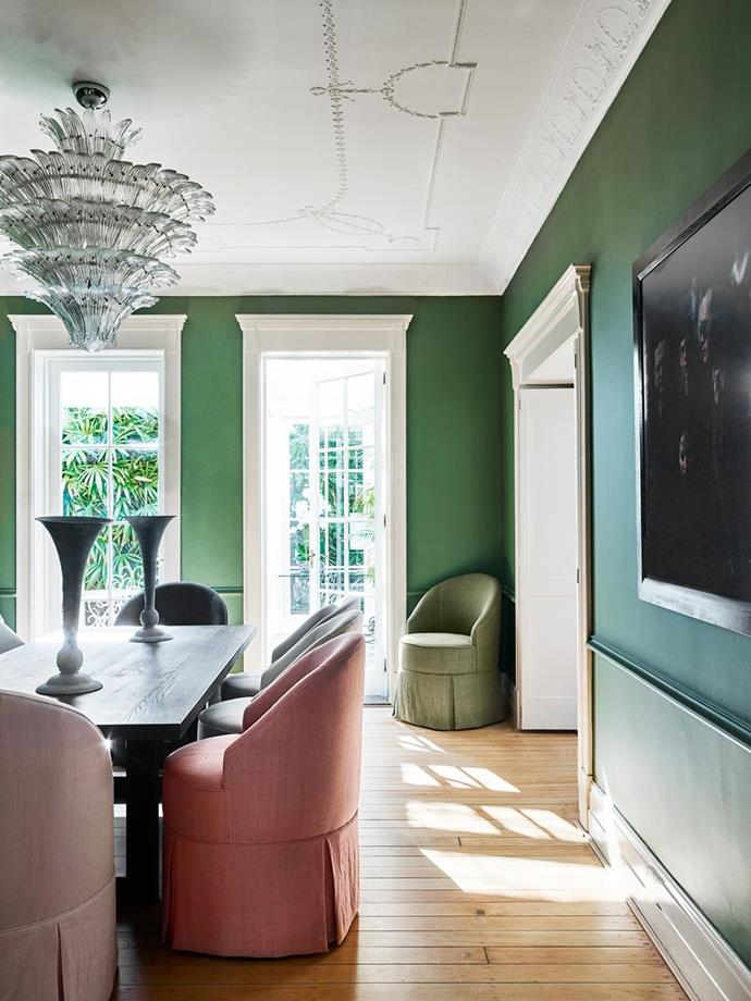 """White french doors stand out against the bold emerald green palette of this formal dining room, allowing streams of natural light into the [historic Sydney home](https://www.homestolove.com.au/youthful-redesign-of-a-historic-heritage-home-6113