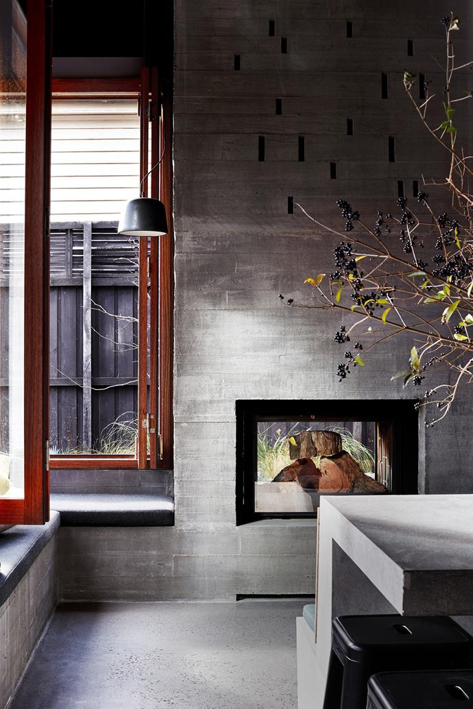"""Who says industrial finishes can't feel warm? This fashionable fireplace is the focal point of the kitchen in this [suburban home in Melbourne's St Kilda](https://www.homestolove.com.au/architects-serve-up-cafe-aesthetic-for-suburban-home-3089 target=""""_blank"""").  *Photographer: Sean Fennessy   Story: Belle*"""