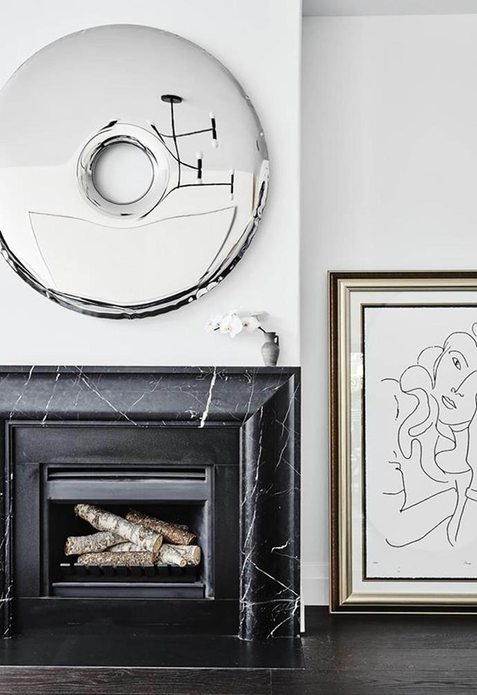 """Designer Melissa Koch was engaged to retain the original character of [this Federation home](https://www.homestolove.com.au/federation-townhouse-modern-makeover-19773 target=""""_blank"""") while updating it to feel tailored, modern and refined. She nailed the brief with a mix of abstract and contemporary art alongside a well-preserved fireplace.  *Photographer: Will Horner*"""
