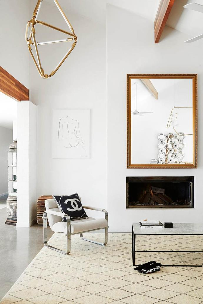 """Safe to say that fashion influencer Amanda Shadforth knows a thing or two about style. Her 1970s home has a [Palm Springs vibe](https://www.homestolove.com.au/oracle-fox-amanda-shadforth-home-20153 target=""""_blank"""") and features a pared-back aesthetic with a minimalistic approach, and a streamline fireplace for warmth.  *Photographer: Julie Adams   Stylist: Kristin Rawson   Story: real living*"""