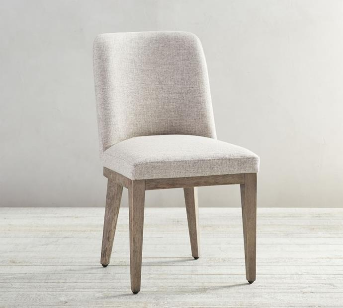 """Inside of your standard [office chair](https://www.homestolove.com.au/ergonomic-chair-best-21214 target=""""_blank""""), Meghan has opted for an extra soft, padded dining chair to keep her posture perfect during working hours. Pottery Barn's Layton dining chair, upholstered in 'seadrift', will bring just as much comfort and style to your office.  **Layton Upholstered Dining Chair, $499, [Pottery Barn](https://www.potterybarn.com.au/layton-upholstered-dining-chair?location=&quantity=1&attribute_1=Seadrift target=""""_blank"""" rel=""""nofollow"""").**"""