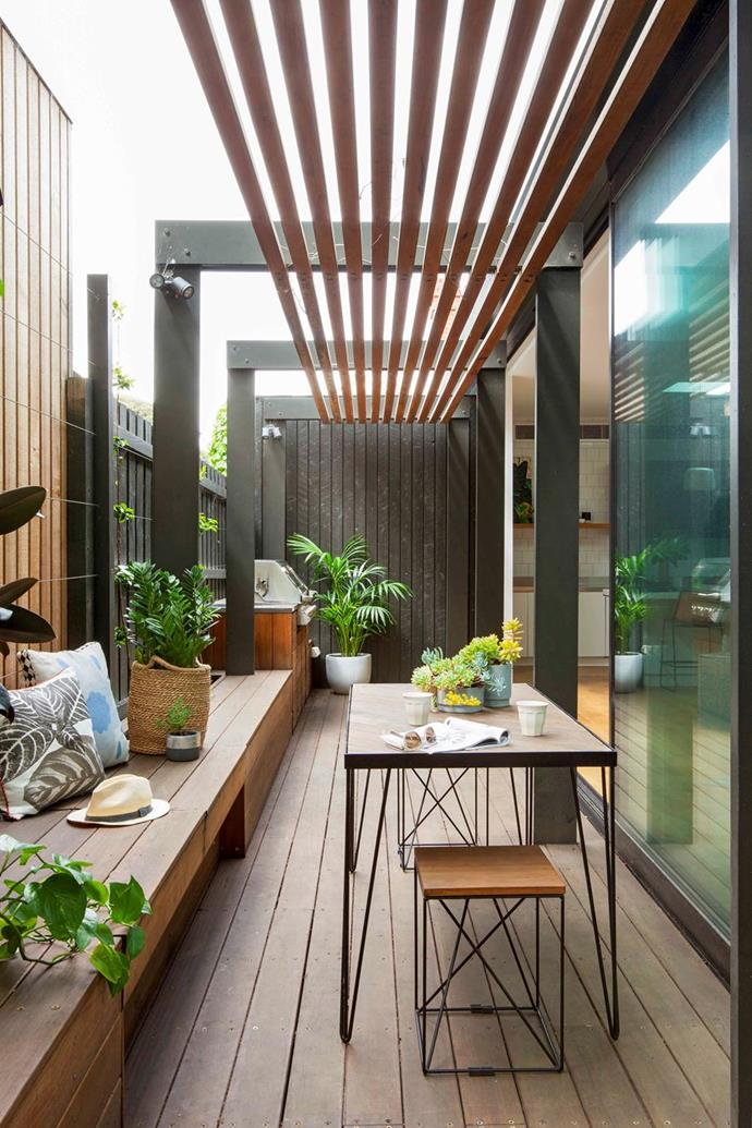 """""""The built-in benches and storage keep it clutter-free and, in time, the vines will grow up the fence to create a lovely green oasis, visible from the living room,"""" said the owner of this balcony added to a [period home in Melbourne](https://www.homestolove.com.au/modern-extension-period-home-21650
