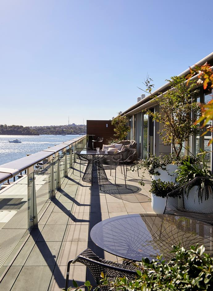 Emu 'Heaven' outdoor settings from Ke-Zu take in glittering harbour views along the western terrace interspersed with clustered planters from Garden Life and a B&B Italia daybed from Space.