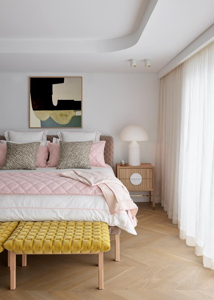 Artwork by Leonie Barton from Curatorial+Co. Ligne Roset 'Ruché' bed and footstools from Domo with 'Astoria' throw and 'Shatter' cushion, both from Greg Natale. 'Halo' bedside table from Zuster with Flos 'Atollo' lamp from Euroluce.