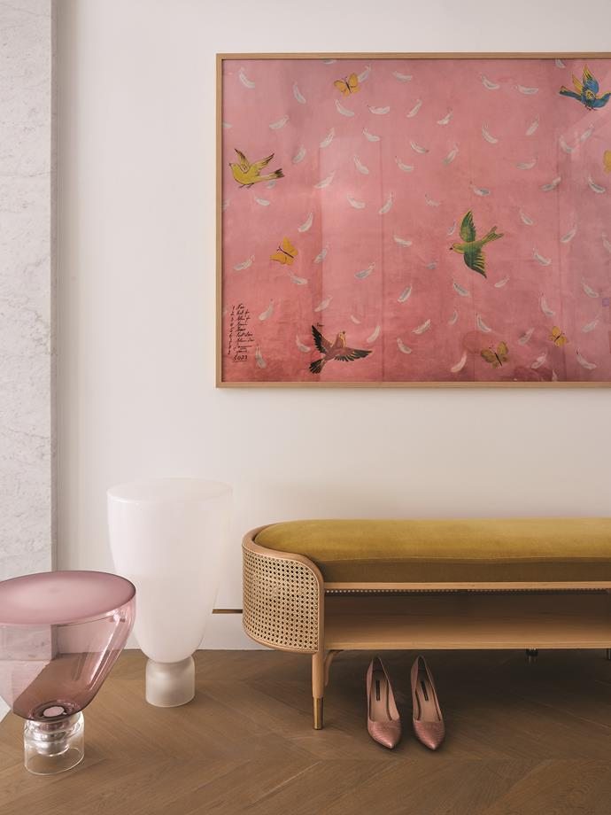 Feathers by Paule Marrot from Natural Curiosities hangs in the entry above a Gebrüder Thonet Vienna 'Mos' bench from Space.