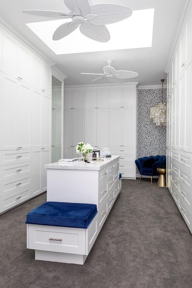 """The dream five-start wardrobe in this [grand Hamptons-style home](https://www.homestolove.com.au/waterfront-home-gold-coast-21855 target=""""_blank"""") includes an incredible amount of built-in storage and is bought to life with luxurious accents of blue velvet."""