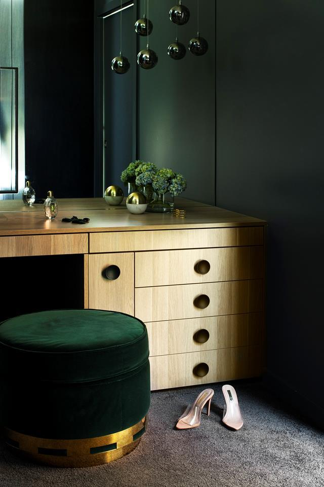 """A pull-out appliance drawer contains concealed power points, ensuring an uncluttered bench space in the wardrobe of this [spacious new build in South Sydney](https://www.homestolove.com.au/spacious-new-build-south-sydney-21935 target=""""_blank"""")."""