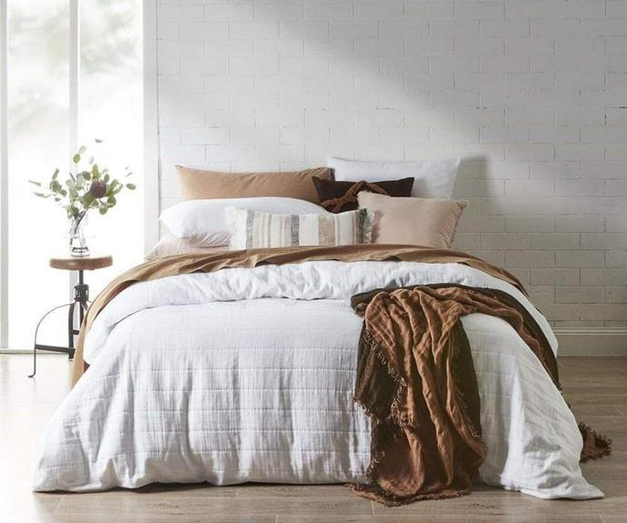 """White bedding is always classic and the cotton **[Braemar quilt cover in queen, $219](https://www.house.com.au/neale-whitaker-braemar-quilt-cover-queen-white target=""""_blank"""" rel=""""nofollow"""")** features a textural weave that beautifully captures light and shadow. Hurry, this cover has proven particularly popular, with only 12 sets remaining."""