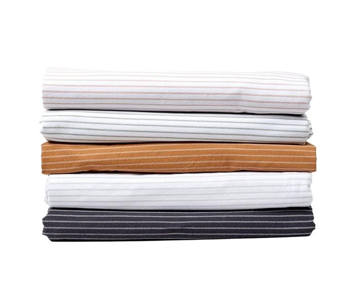 """The subtle striped design of Neale's **[Queen sheet set in 'Desert', $289.99](https://www.house.com.au/neale-whitaker-sheet-set-queen-desert target=""""_blank"""" rel=""""nofollow"""")** will add a touch of sophistication to your bedroom. Made from premium yarn dyed cotton, this set includes a pair of standard pillowcases. Multiple shades available."""