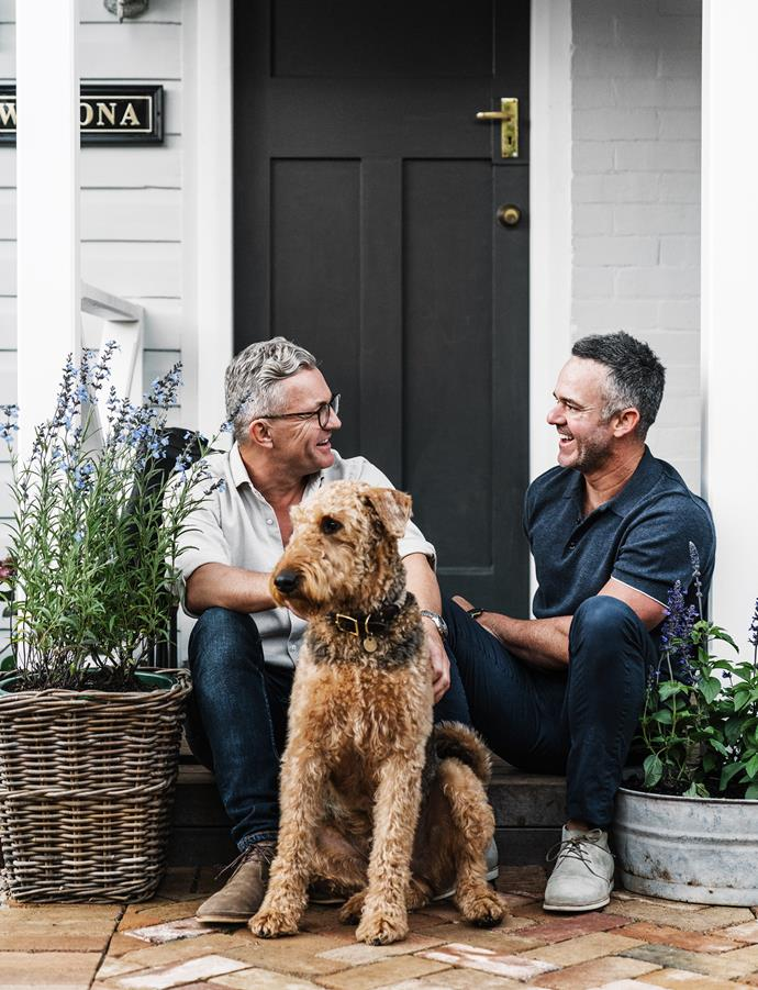 James (left) and Tony with their Airedale terrier, Teddy. The exterior is painted Porter's Paints Salt Wattle. The front door is Porter's Paints Cosmos. Basket and planter, both vintage.