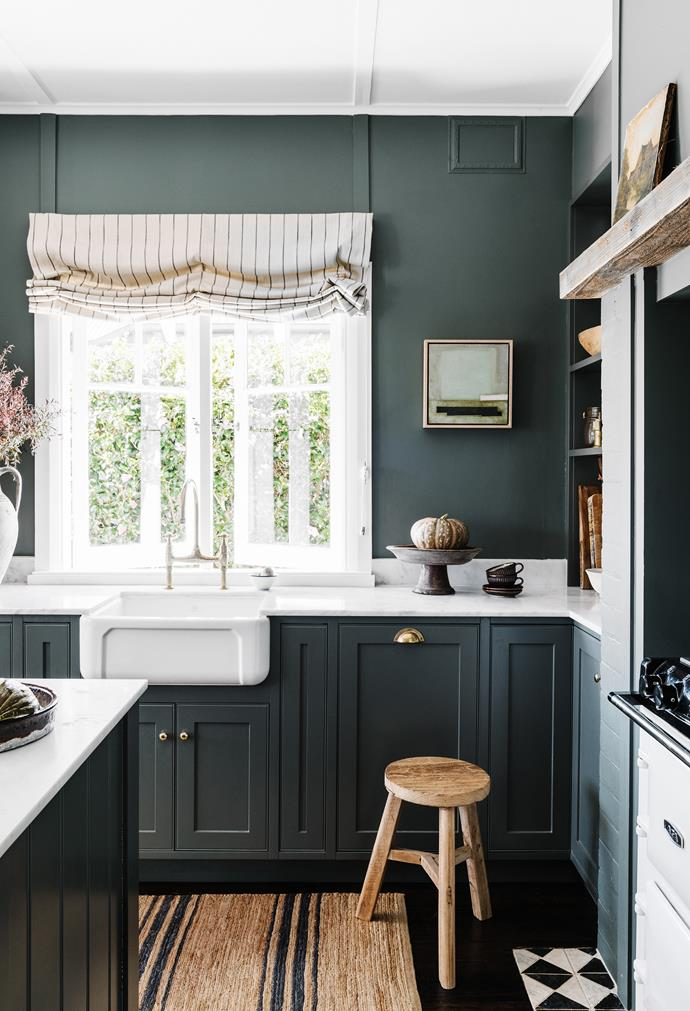 Benchtop is Bianca Carrara marble, CDK Stone. Joinery and walls painted Porter's Paints Highlands Grey. Blinds, No Chintz. Chambord sink, Abey. Kitchen mixer, The English Tapware Company.  Low stool, Saardé. Artwork next to sink by Leonie Barton, Curatorial+Co.