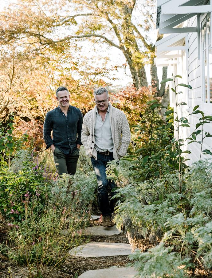 Tony (left) and James step through the side garden featuring  Artemisia 'Powis Castle' and Magnolia 'Teddy Bear'. Bluestone steppers, Eco Outdoor.