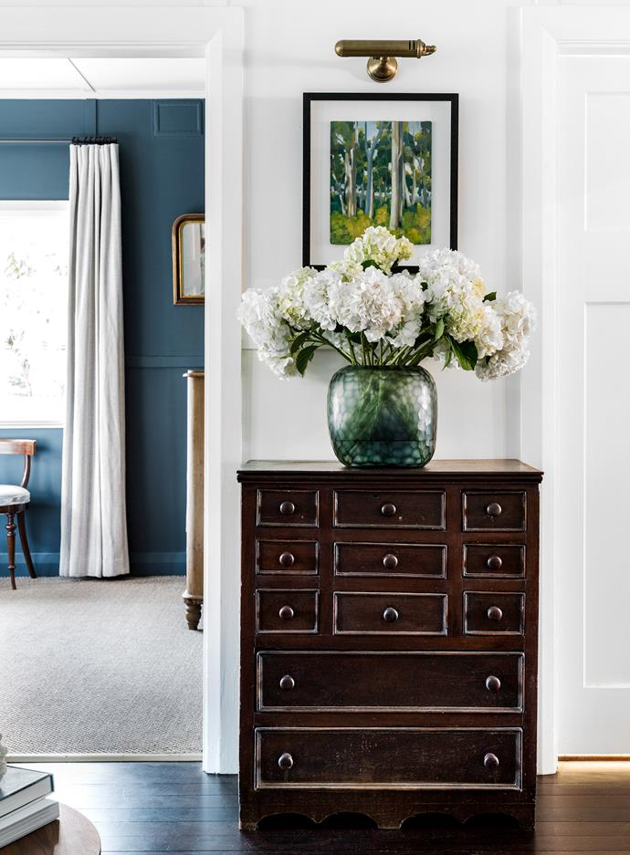 Chest of drawers, The Bay Tree. Guaxs vase, Conley & Co. Wall sconce, Emac & Lawton. Artwork by James King.