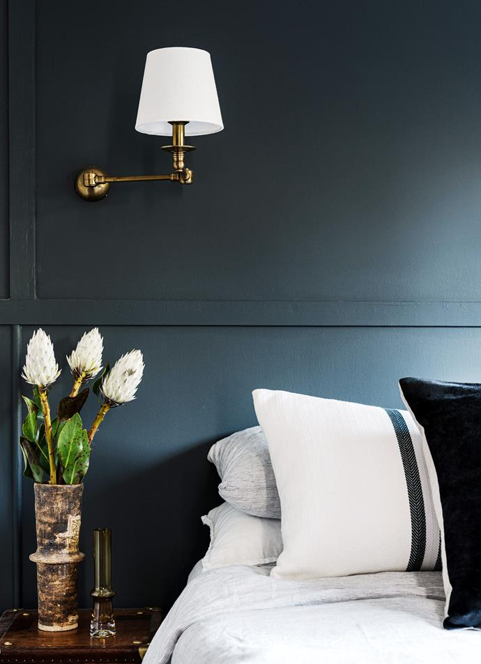 Walls painted Porter's Paints North Sea. Wall light, Emac & Lawton. Bedlinen, Cultiver. Cushions, Amara Home.