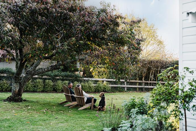 James, Tony and Teddy soak up the serenity, sitting under a cherry tree in their side garden. Outdoor chairs, Cotswold In/Out Furniture.