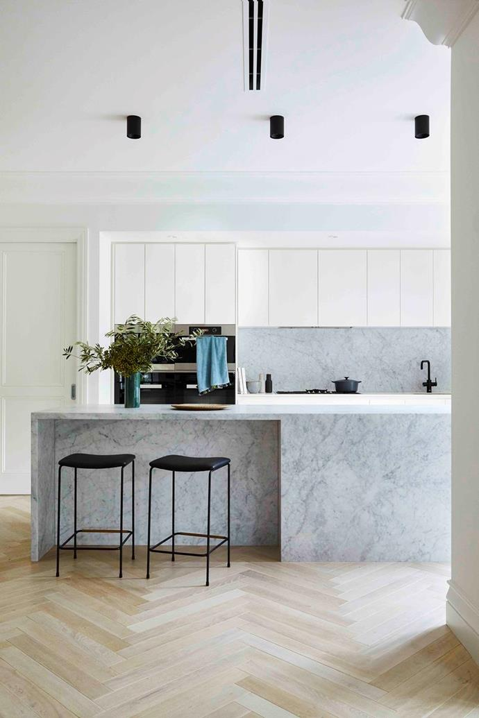 """The cooking zone in this [modern Spanish-style home](https://www.homestolove.com.au/modern-spanish-style-home-melbourne-21563