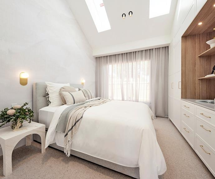 """Ronnie and Georgia's guest bedroom featured soaring ceilings. All bedding, cushions and throw rugs from [Aura Home](https://www.aurahome.com.au/the-block/the-block-2021/ronnieandgeorgia