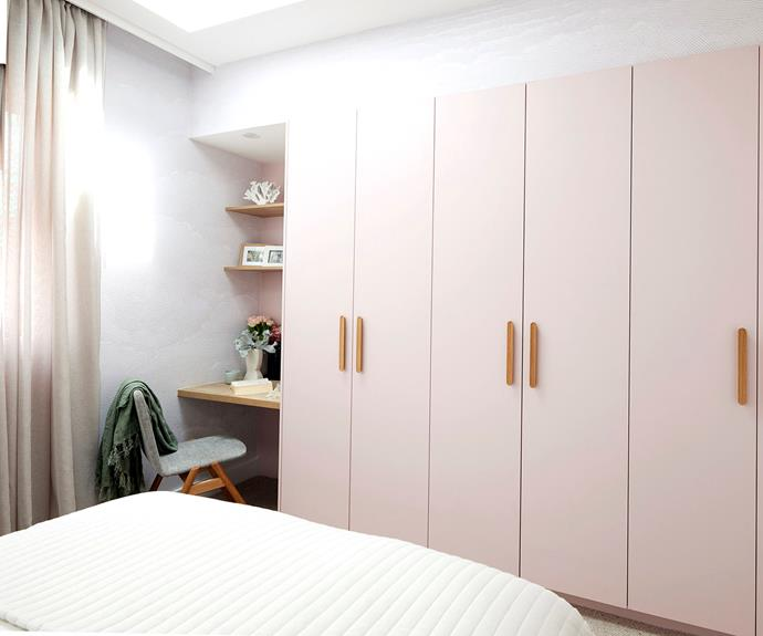 The pink wardrobe doors were one of the only things Neale liked about the room.