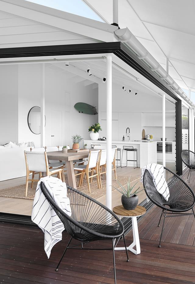 """The interiors, originally designed by Brooke Marsh, gave owners Genny and Chris a great starting point for their [four-bedroom house](https://www.homestolove.com.au/bright-and-breezy-home-coastal-queensland-22044/