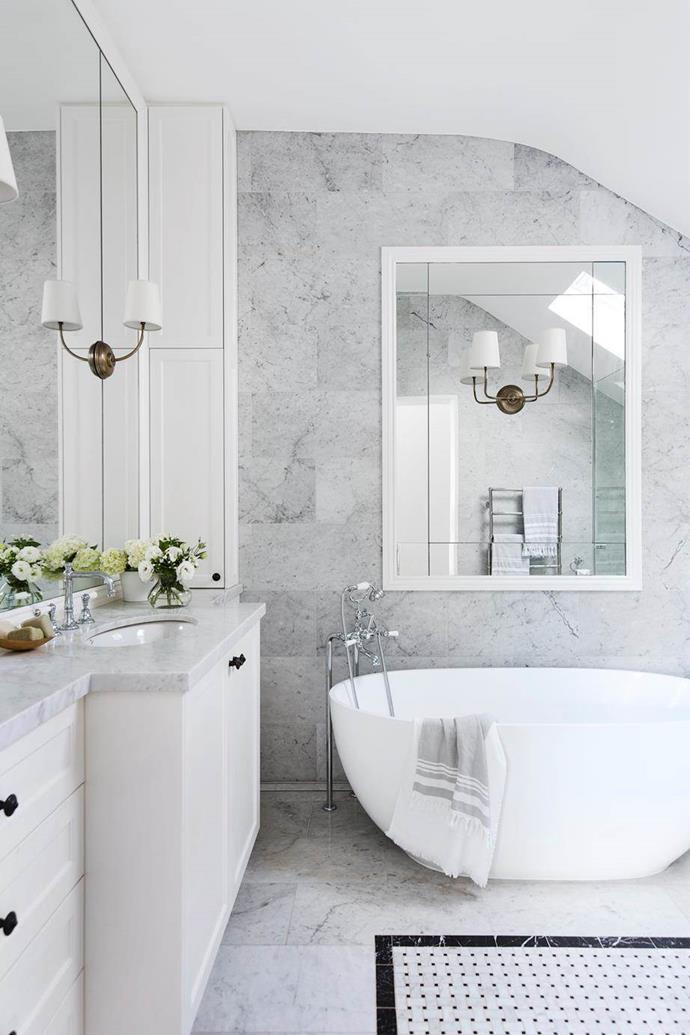 """Exquisite Carrara marble wall and floor tiles distinguish the bathroom in this restoration of this [1870's heritage house in Sydney](https://www.homestolove.com.au/sydney-1870s-heritage-house-restoration-6030