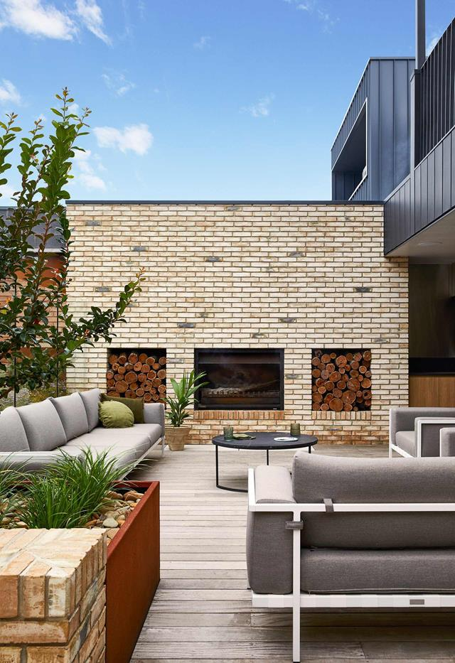 """Extending from the family room of this [contemporary family house](https://www.homestolove.com.au/contemporary-family-house-torquay-22236/
