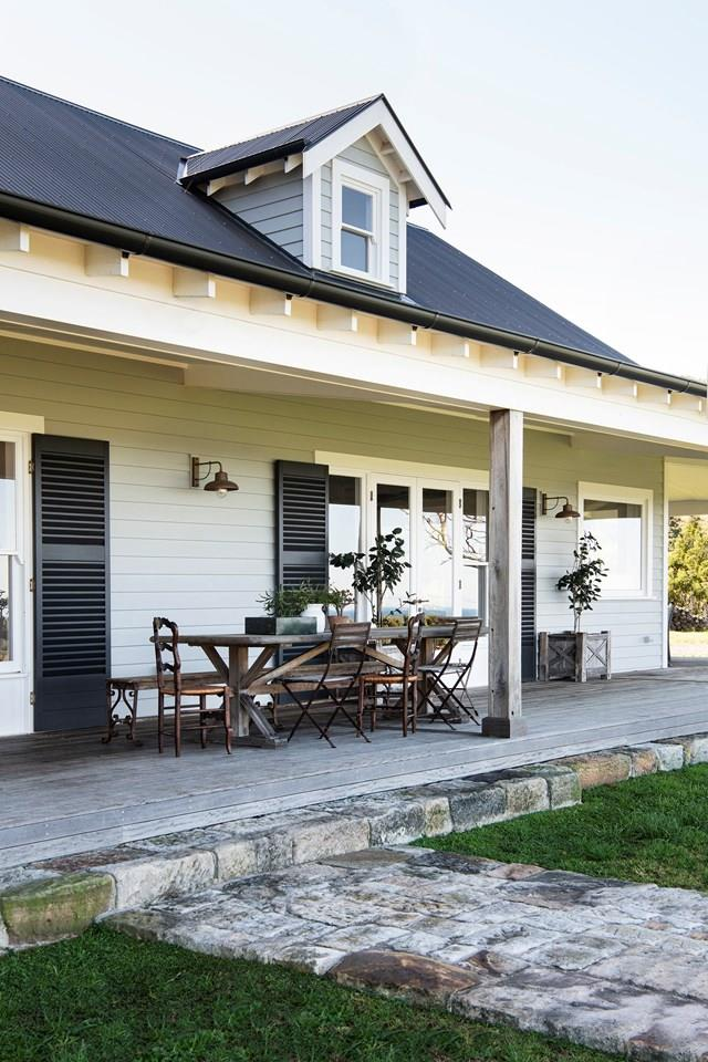 """While the stone pathway and weathered timber details give the impression that this [French-inspired farmhouse](https://www.homestolove.com.au/modern-farmhouse-french-interior-21917/