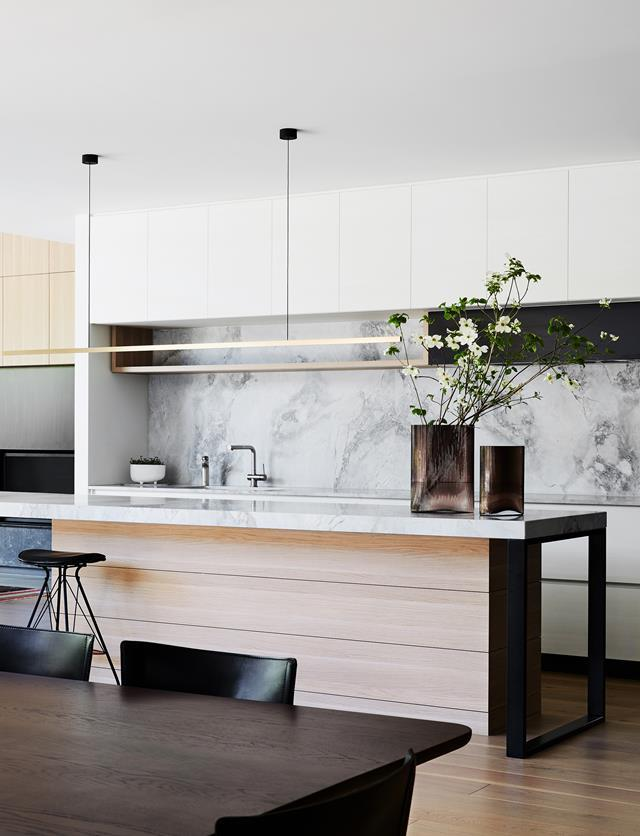 """According to interior designer Simone Haag, the key to a successful interior is building your scheme around one show-stopping hero piece. """"The kitchen island bench is the showpiece of the [kitchen](https://www.homestolove.com.au/simone-haag-interior-styling-tips-21706/ target=""""_blank"""")/ target=""""_blank""""),"""" says designer David Neil. """"The Superwhite Dolomite honed stone top is soft and inviting and looks more like a piece of furniture, with looped legs at each end, and it has seating on both sides to fit the whole family."""""""