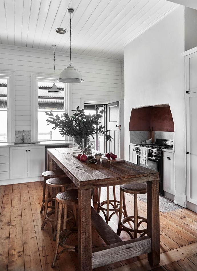"""Interior designer Julie Johnson was charged with the [restoration of her brick homestead](https://www.homestolove.com.au/brick-country-home-restoration-21450/ target=""""_blank"""") in Murchison, VIC and it was in the kitchen that the home's rich history was captured. Timber from the shed, which bears the names and dates of the shearers who worked there, was used to make the kitchen's island bench."""
