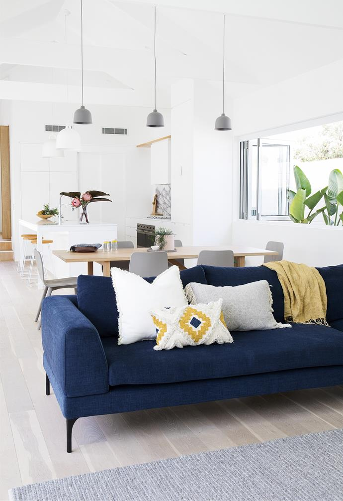 A 'Plaza' sofa from King Living with assorted Adairs cushions is the perfect spot to relax. Although there's no carpet in the house, rugs such as the one from Sheridan create a soft area for Navah and Sheppard to play on.