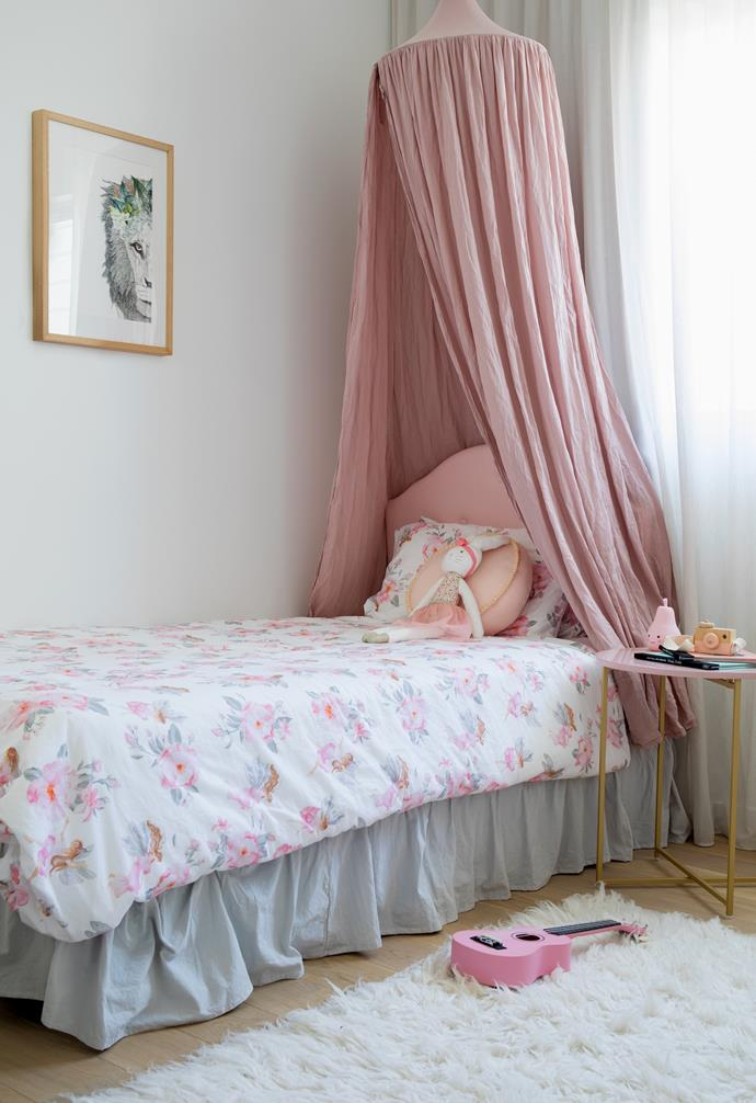 A little girl's paradise, Navah's room is a sweet retreat. A Numero 74 canopy in Dusty Pink makes the bed the star of the space, with sophisticated shades of the pink picked up in the bed, linen and bedside table, sourced from Adairs. Timber boards are softened with a Flokati rug so Navah can comfortably play on the floor. To avoid changing artwork down the track, Danielle opted for a 'Leo The Lion With Foliage Crown' print by Donna Taylor, which will still suit the space when Navah is older.
