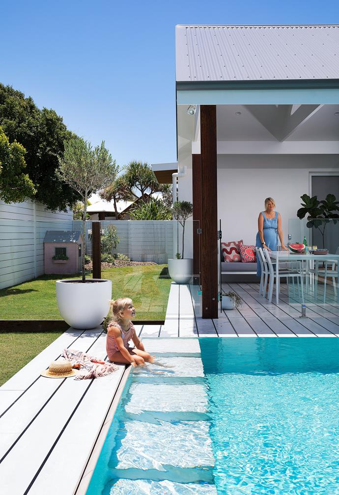 """""""When we look online to book a holiday house, it's hard to find a place that is an improvement on this one,"""" says owner Danielle, keeping an eye on daughter Navah."""