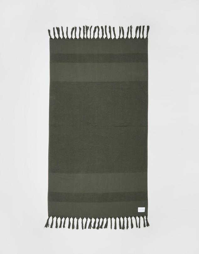 """**Bondi Born Turkish & Terry Beach Towel, $80, [The Iconic](https://www.theiconic.com.au/turkish-terry-beach-towel-1012619.html target=""""_blank"""" rel=""""nofollow"""")**  Olive green looks great in nature, and we think Bondi Born's khaki towel is the naturally beautiful edition your beach kit needs. Plus, the Sydney fashion brand created the towel from heavy organic cotton so it's not only a stylish choice, but a sustainable one too."""