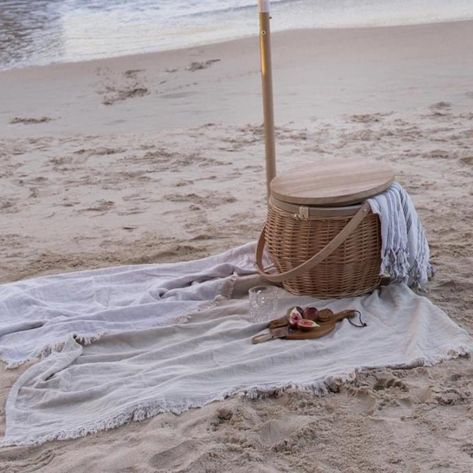 """**Reversible Beach Blanket in Ivory, $169, [Land and Sand Essentials](https://www.landandsandessentials.com.au/collections/beach-blankets/products/beach-blanket-reversible-1 target=""""_blank"""" rel=""""nofollow"""")**   If you have a family, sometimes the average beach towel is just too small. Upsize with the beach blanket from Land and Sea that's as big as your average picnic rug, but far more chic! It's also available in an olive or saffron shade."""