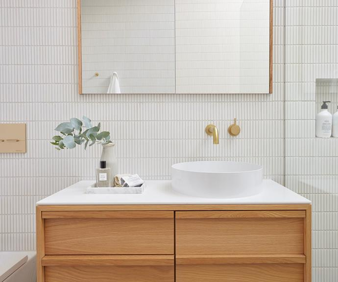 """Ronnie and Georgia chose a floating American oak vanity and a white basin with a gloss finish. Vase from [Schots Home Emporium](https://www.schots.com.au/