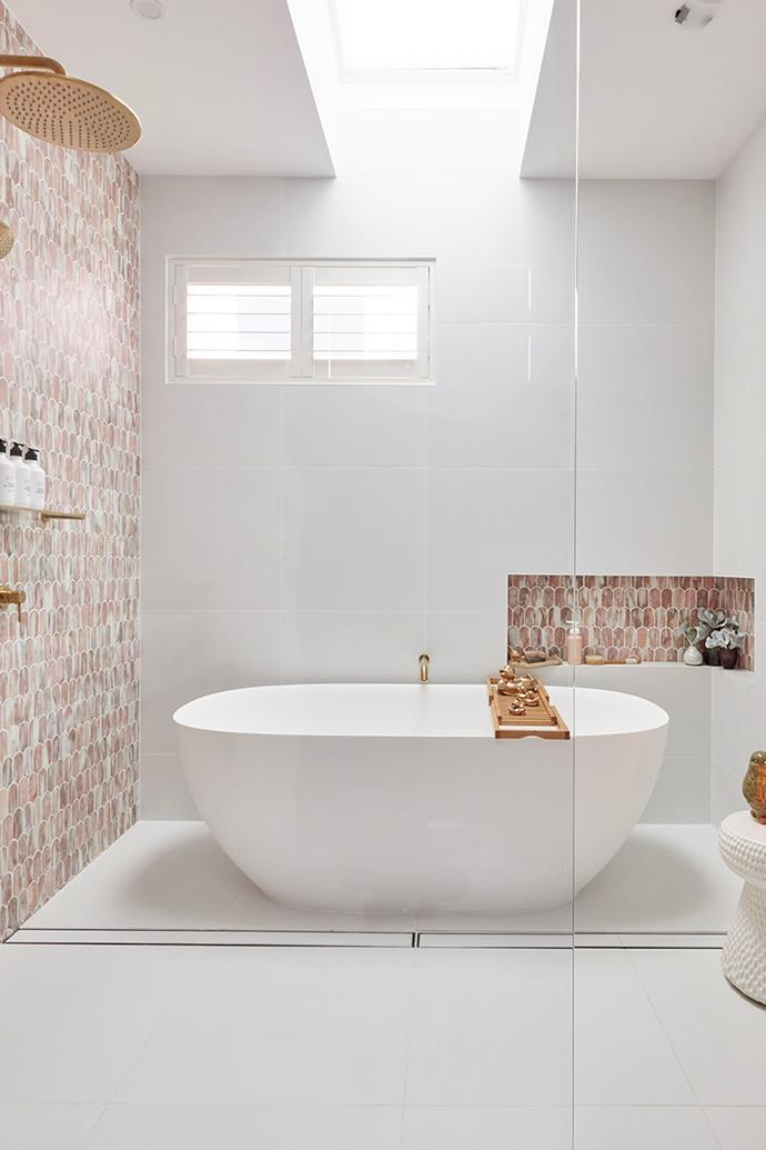 """Mitch and Mark's """"punchy"""" bathroom featured soft-pink marble fan tiles. Mitch styled the bath with a family of rubber ducks he spray-painted gold."""