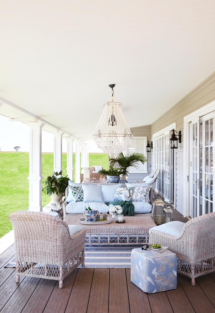"""Blue and white soft furnishings complement this Hamptons-style home exterior. An 1860s cottage held by a family for five generations forms the sentimental heart of the [palatial Hamptons-inspired farmhouse](https://www.homestolove.com.au/grand-hamptons-country-farmhouse-22797