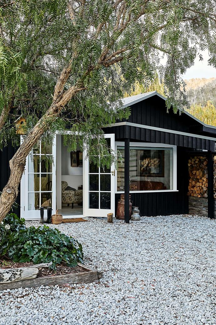 The exterior of the guesthouse is painted in dulux Black with Dulux Vivid White trims.