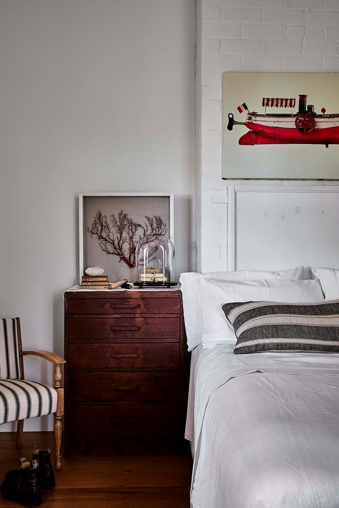 The boat artwork above a bed in the main house is printed on French fabric and was a gift from the home's previous owner.