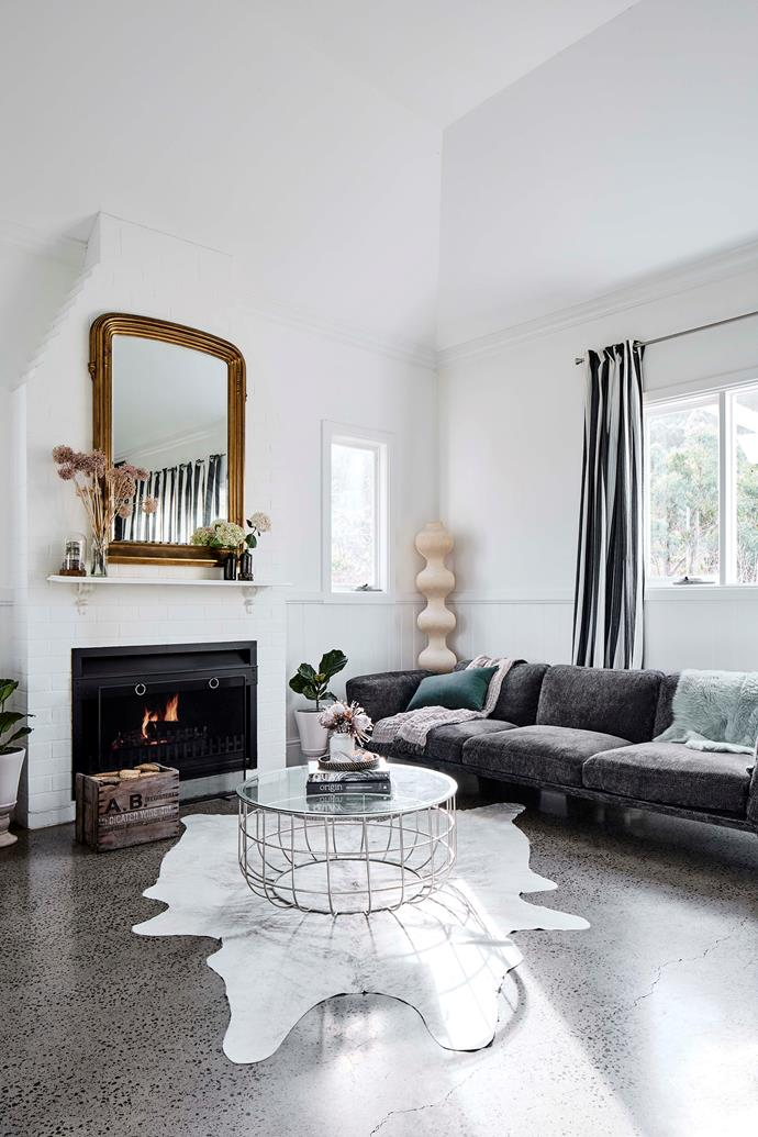 """In the living room, the grey sofa is from [King Furniture](https://www.kingliving.com.au/ target=""""_blank"""" rel=""""nofollow""""). The heated concrete floors were installed by the previous owners."""