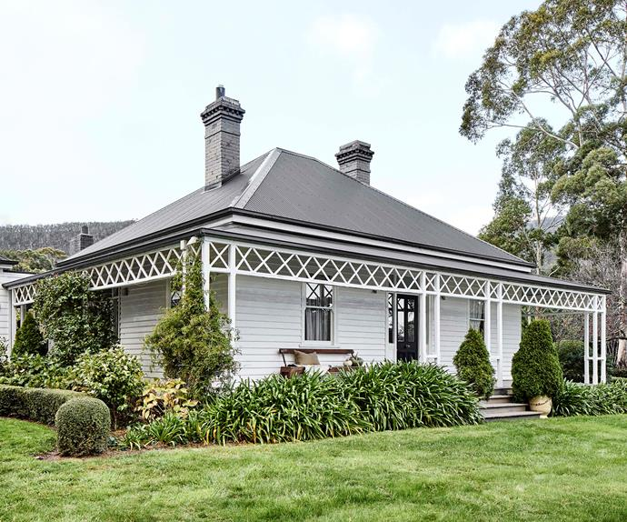 Exterior of heritage listed weatherboard farmhouse at Cloud River Farm in Tasmania